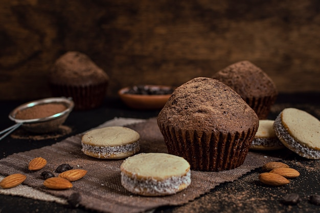 Muffins and cookies with blurred background