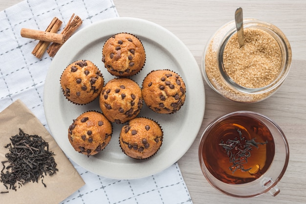 Muffins, cup of tea, tea, sugar, tangerine and cinnamon