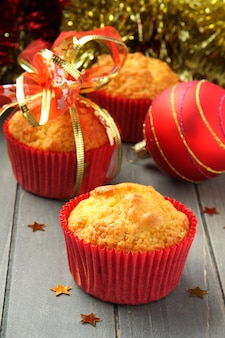 Muffins in red cups with christmas decoration