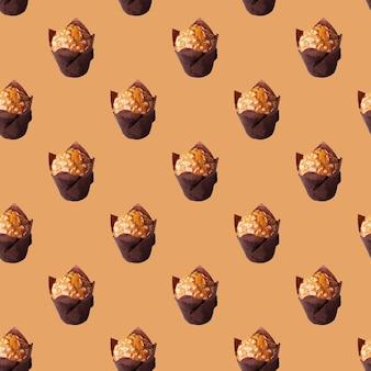 베이지색 배경 원활한 패턴에 아몬드와 머핀