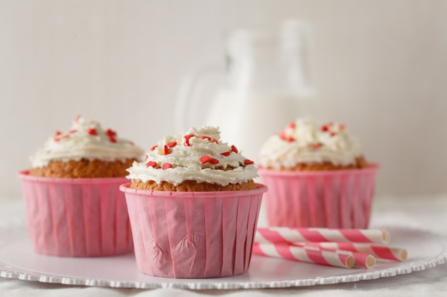 Muffins with heart decorations