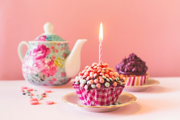Muffins with illuminated candle on birthday