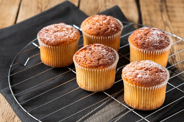Muffins with powdered sugar on tray