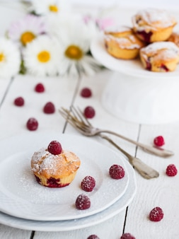 Muffins with raspberries,sprinkled with powdered sugar