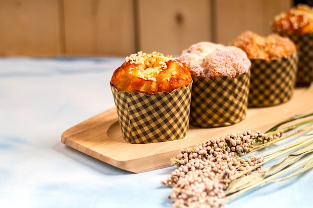 Muffins in wooden dish and table