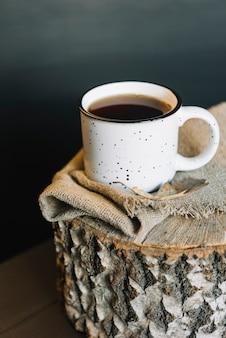 Mug and cloth on stump