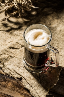 Mug beer with wheat on linen cloth