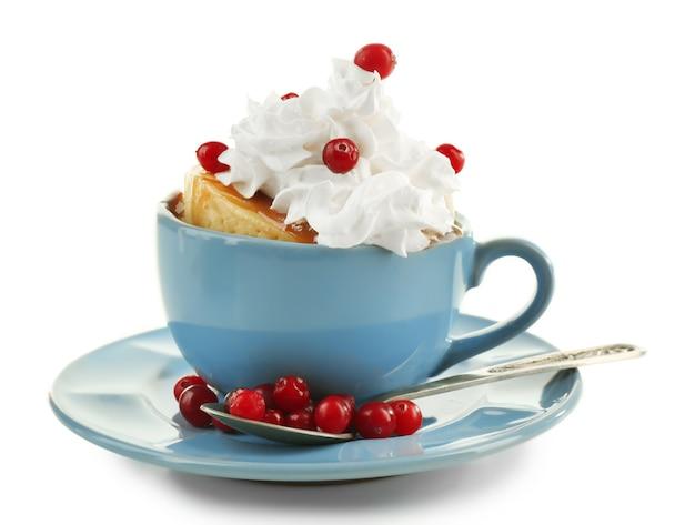 Mug cake with cream and cranberry isolated on white