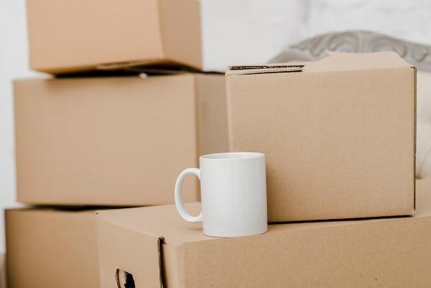 Mug on carton boxes