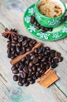 Mug of coffee and beans as a holiday christmas concept
