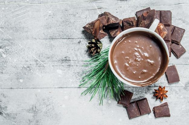 Mug of hot chocolate on rustic table.