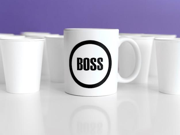 Mug with boss text on table