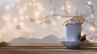 Mug with toy snowflake on plate with cookies on wood table near bank of snow and fairy lights