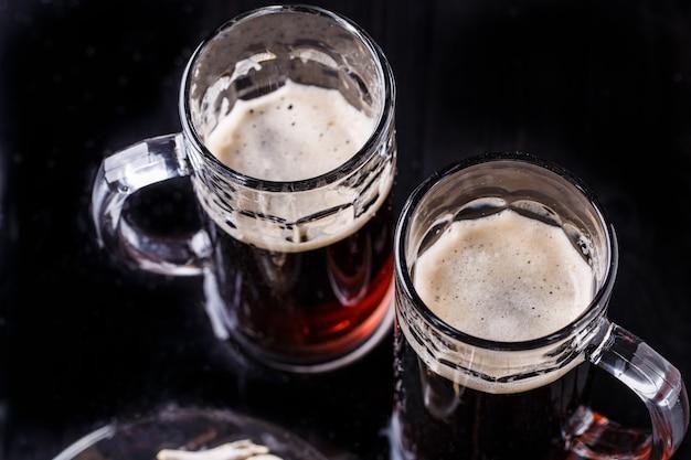 Mugs of beer on table