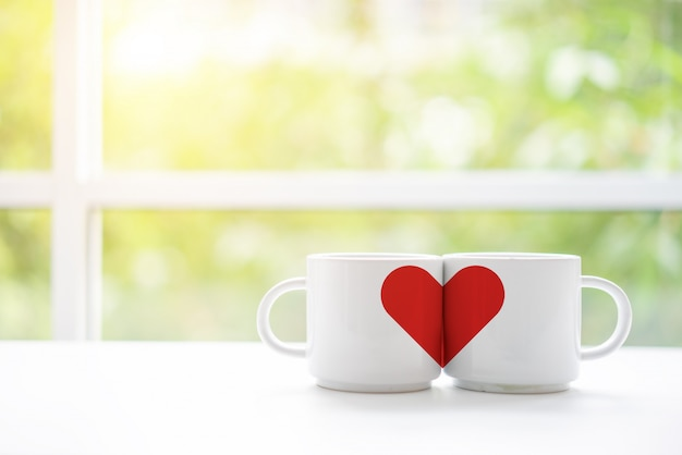 Mugs cups of coffee or tea for two lovers honeymoon wedding morning in coffee shop