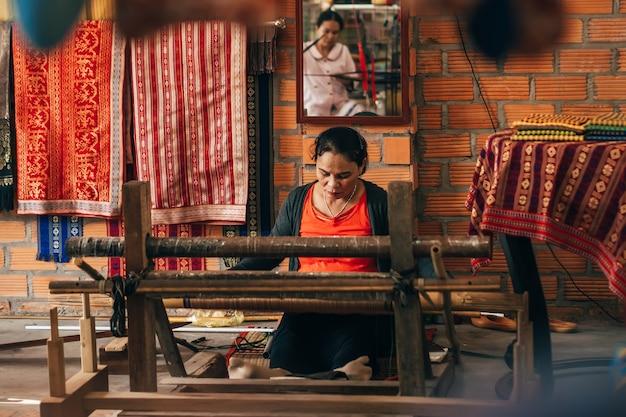 Mui ne, vietnam - march 6, 2017: women weavers work traditional looms for silk