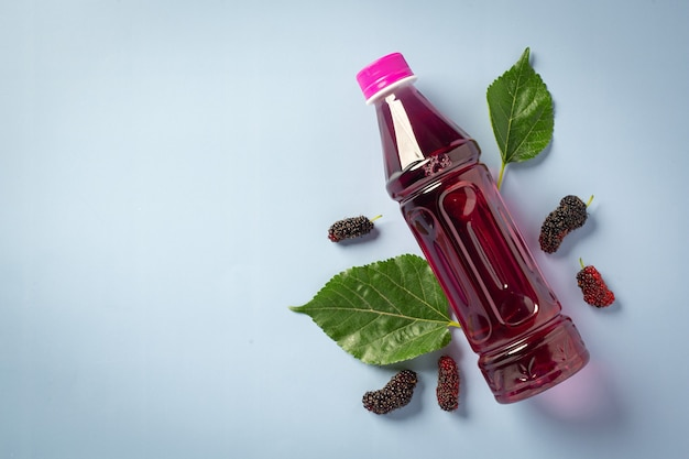 Mulberry juice on blue surface
