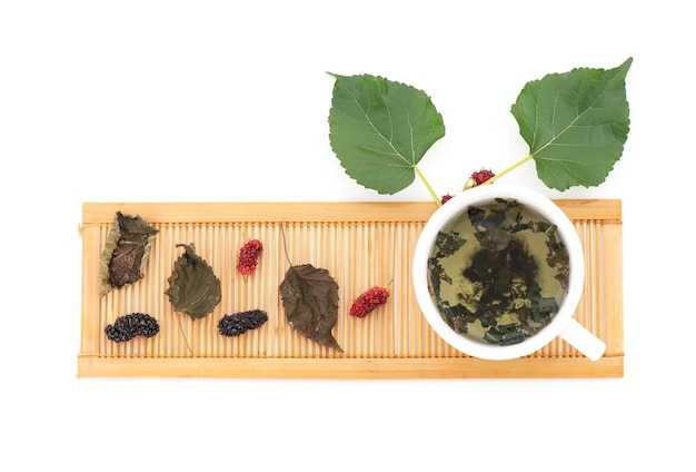 Mulberry and tea isolated on white background.top view,flat lay.