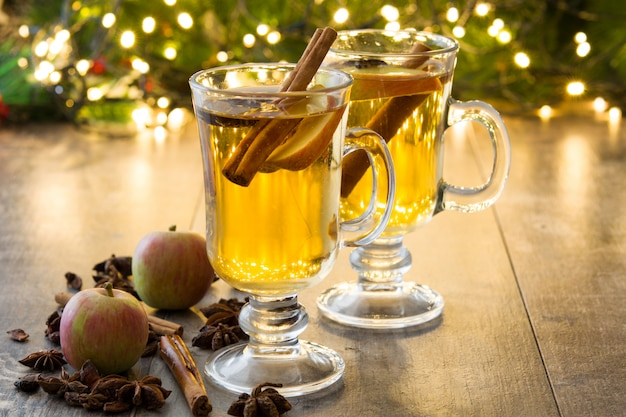 Mulled cider in glass on wooden table christmas drink