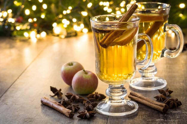 Mulled cider in glass on wooden table copy space christmas drink