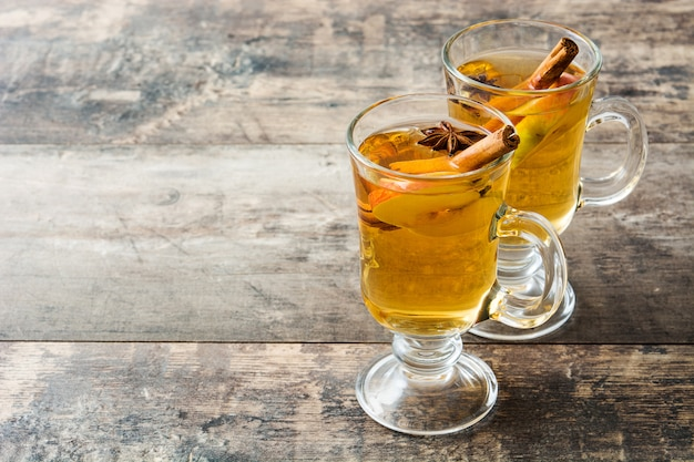 Mulled cider in typical glass on wooden table