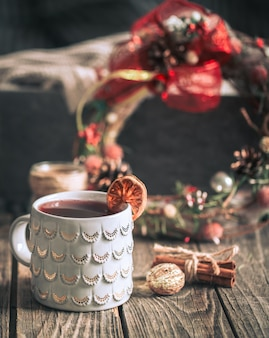 Mulled wine in a cup on a wooden background