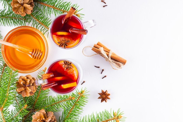Mulled wine in glass mug with spices