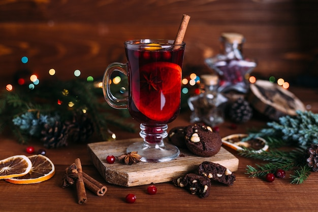 Mulled wine glass with cinnamon and orange