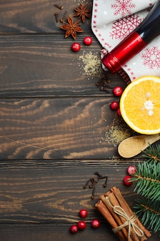 Mulled wine ingredients on a dark wooden background, top view, flat lay, copy space.