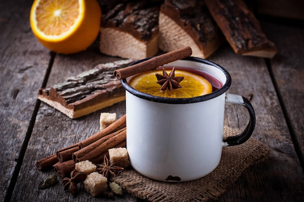 Mulled wine in iron mug. selective focus