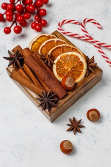 Mulled wine spices in wooden box on table