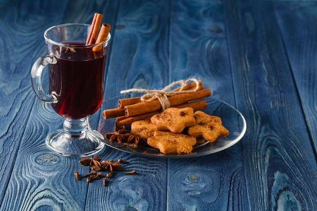 Mulled wine traditional hot spiced alcohol winter season beverage with cinnamon, orange, anise and other spices. thanksgiving holiday celebration recipe
