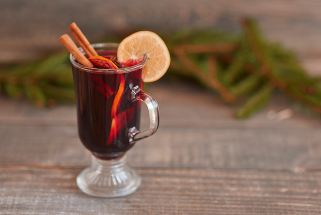 Mulled wine with cinnamon stick and lemon