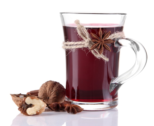 Mulled wine with nuts and spices on white