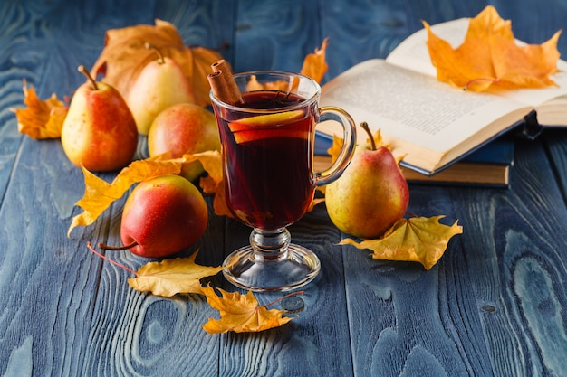 Mulled wine with orange and spices on dark background with copy space