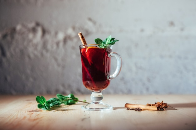 Mulled wine with slice of orange  spices.