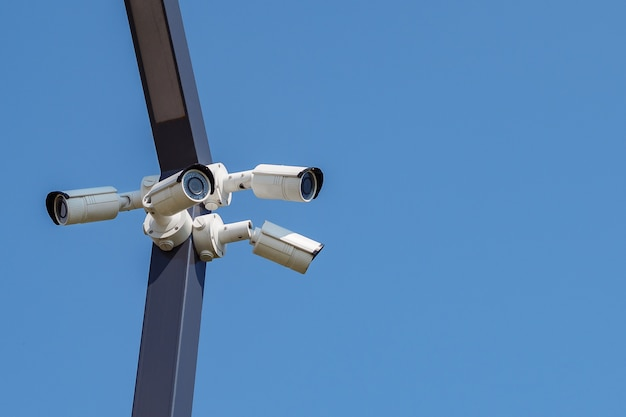 Multi-angle cctv surveillance security camera video equipment on the blue sky