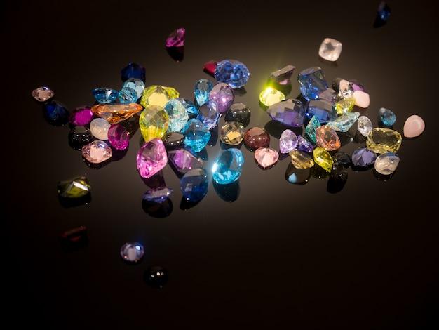 Multi color of gemstone or gems on black shine table