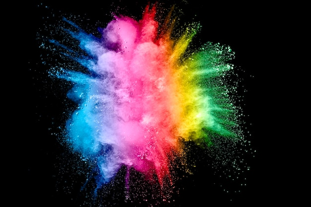 Multi color powder explosion on black background.