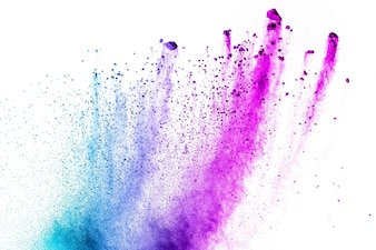 Multi color powder explosion on white background. Launched colorful dust particles splashi
