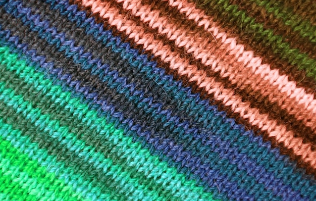 Multi-color striped alpaca knitted wool fabric texture for background