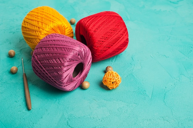 Multi color yarn balls on mint background