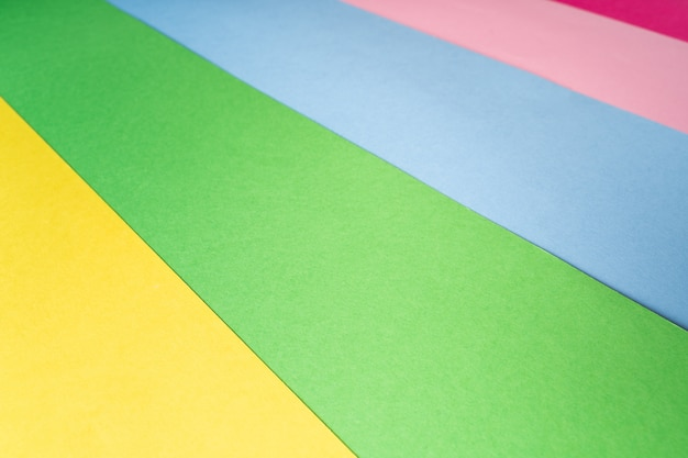 Multi colored abstract paper of pastel colors with geometric shape.