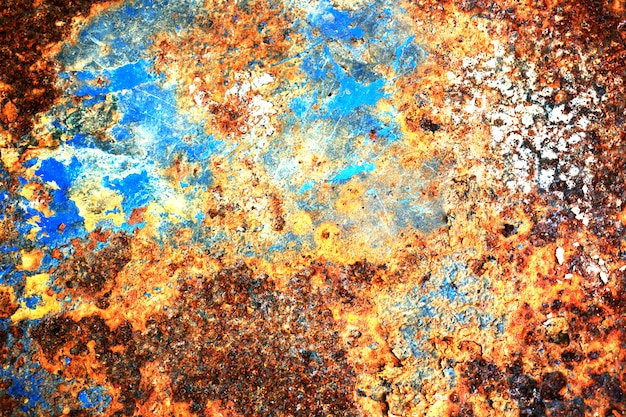 Multi colored background, rusty metal surface with blue point texture flaking and cracking