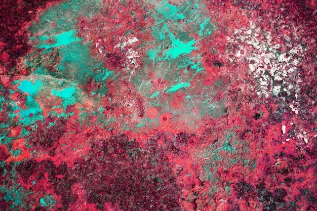 Multi-colored background, rusty metal surface with crimson and dot texture peeling and cracking