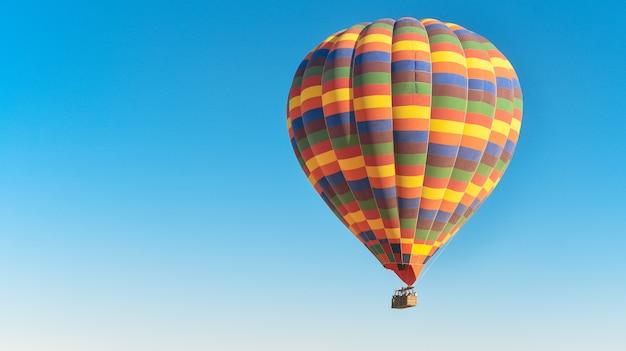 Multi-colored balloon flying in the sky in cappadocia