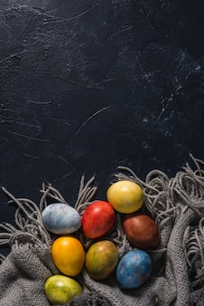 Multi-colored bright easter eggs. easter eggs on a dark background.