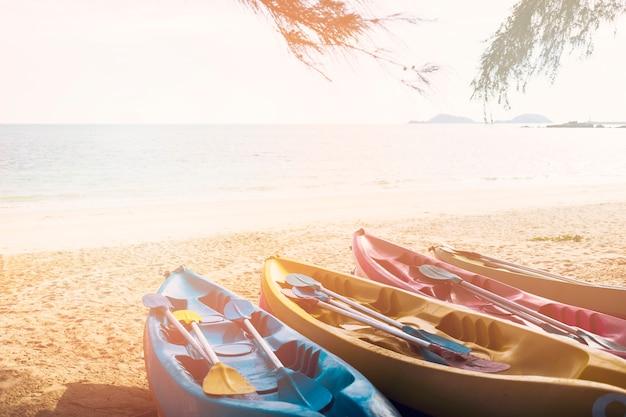 Multi colored canoe's on beach