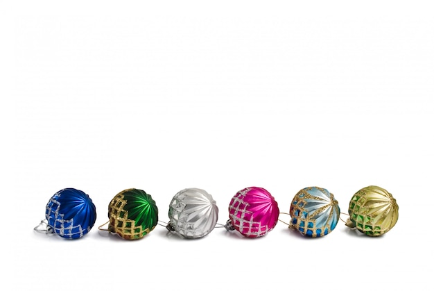 Multi-colored christmas balls on white