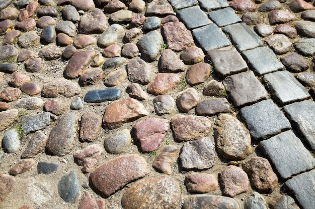 Multi-colored combined road made of tiles or cobblestones for traffic and people